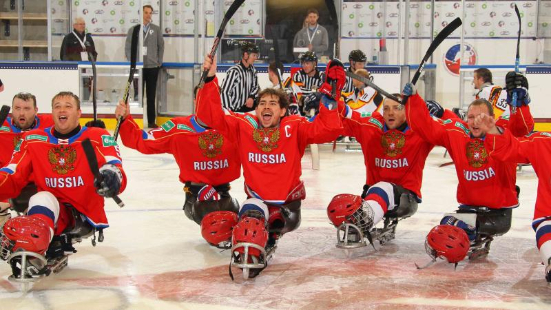 Russian captain Dmitrii Lisov celebrates with his teammates after defeating Germany at Buffalo 2015.