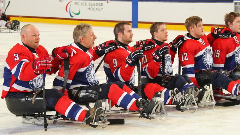 Norway's team listens to their national anthem after defeating Japan in their final prelminary round game at Buffalo 2015.