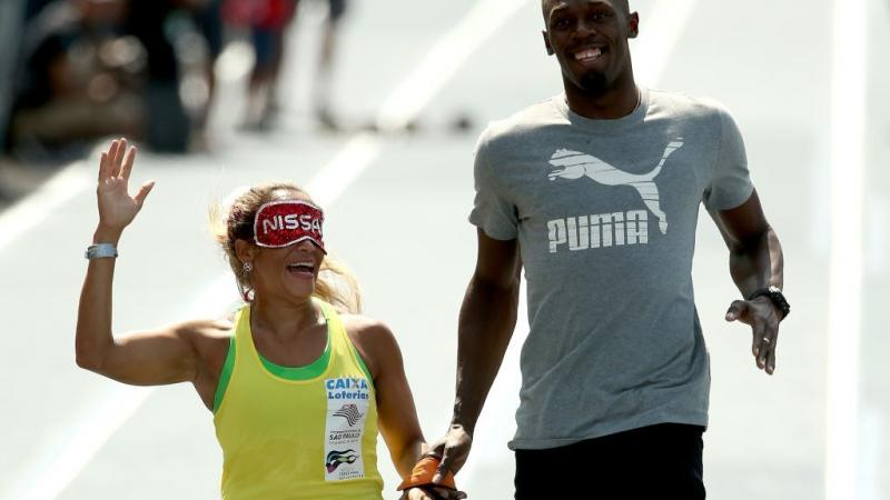 Paralympian Terezinha Guilhermina of Brazil runs with Usain Bolt of Jamaica as her guide during an exhibition in preparation for the Mano a Mano Athletics Challenge in Rio de Janeiro, Brazil. In 2011, she was elected to the APC Executive Committee at the Guadalajara Parapan American Games.