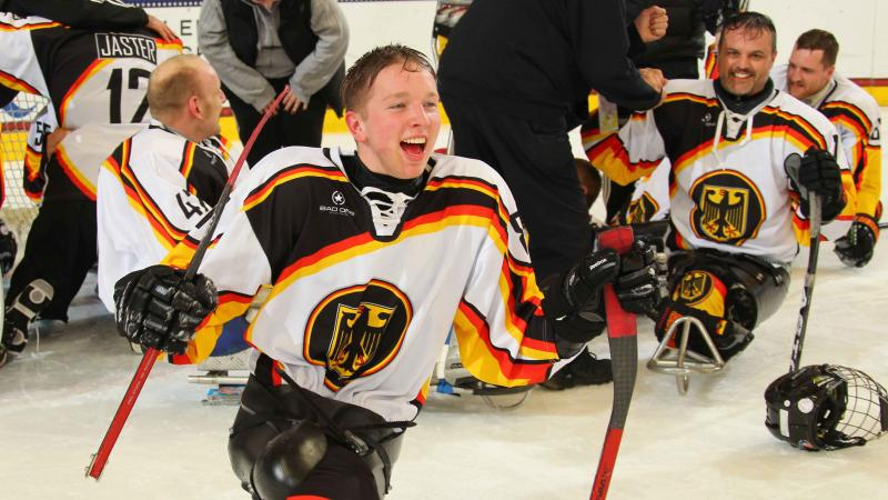 German sledge hockey player cheering.