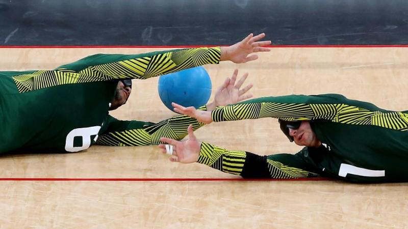 Jose Roberto Ferreira de Oliveira (R) and Romario Diego Marques of Brazil fail to stop a goal during the Men's Group A Goalball match between Finland and Brazil at the London 2012 Paralympic Games.