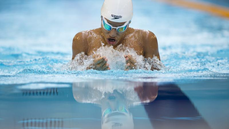 Swimmer in the water, doing breaststroke