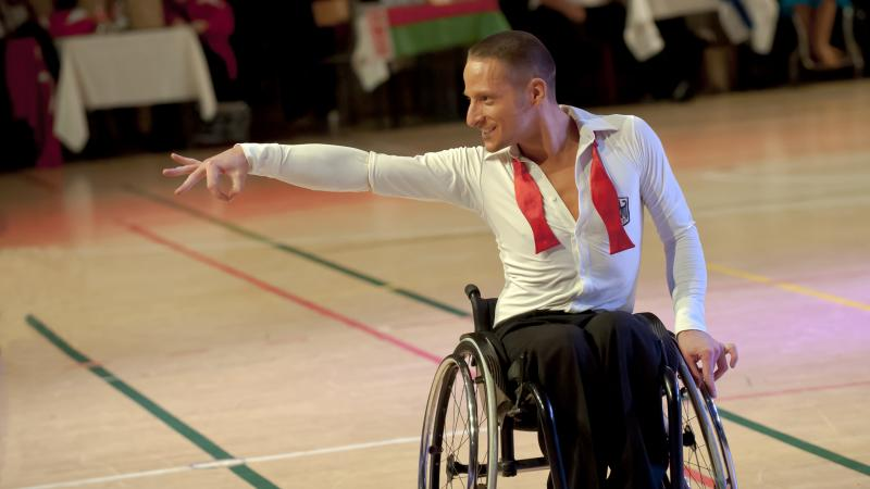 Man in wheelchair doing a dancing pose