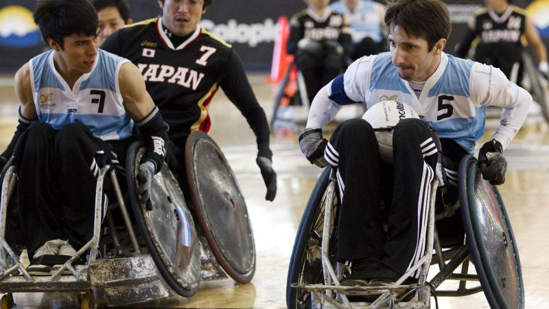 wheelchair rugby players on the field