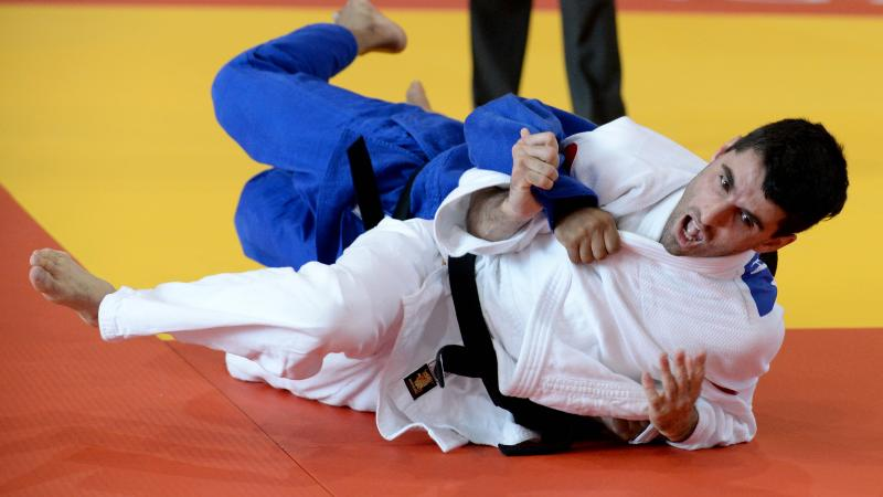 Two judoka on the mat