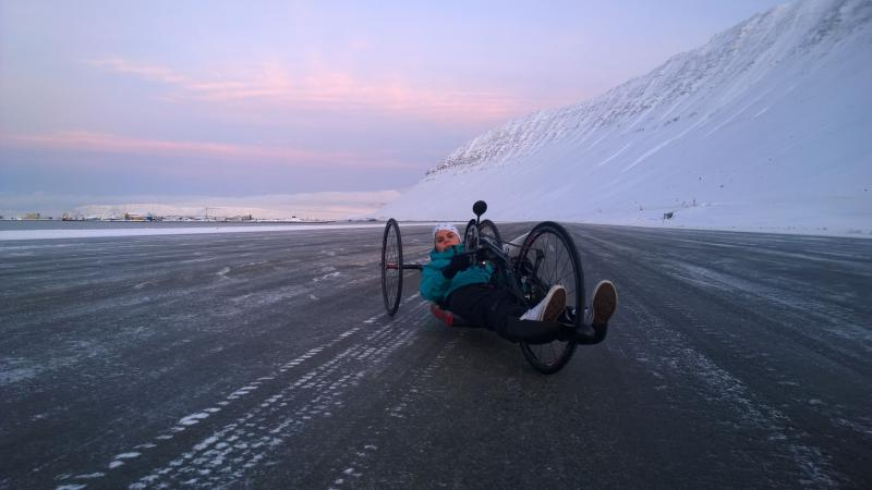 Handcyclist in front of an iced mountain