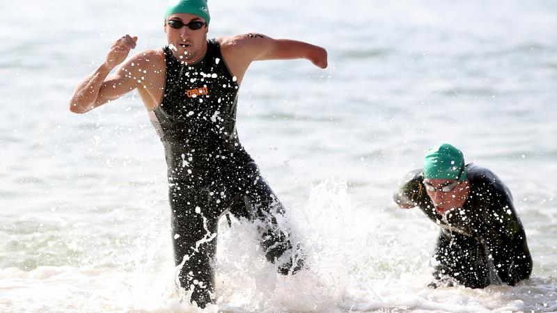 Martin Schulz of Germany emerges from the water in the swim portion of the men's PT4 class during the Aquece Rio Paratriathlon at Copacabana beach.
