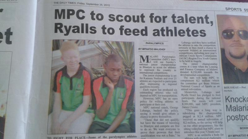 Newspaper article with photo showing two young boys