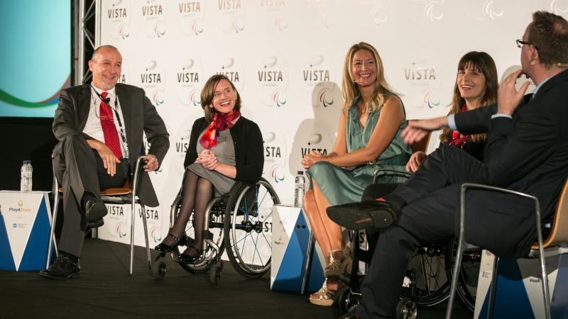 Three women and two men sitting on the podium during a podium discussion at Vista 2015.