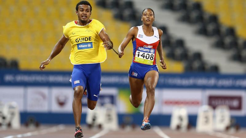 Woman and man sprinting on a track side by side
