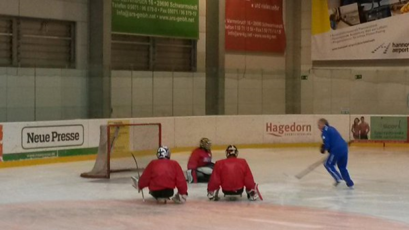 Young ice sledge hockey players take part in a training camp