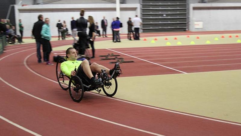 Handcyclist cycling on a track