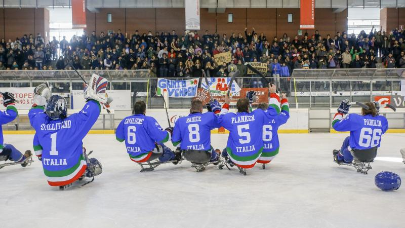 Italian ice sledge hockey players thank their supporters after making it to the final of the international tournament in 2015