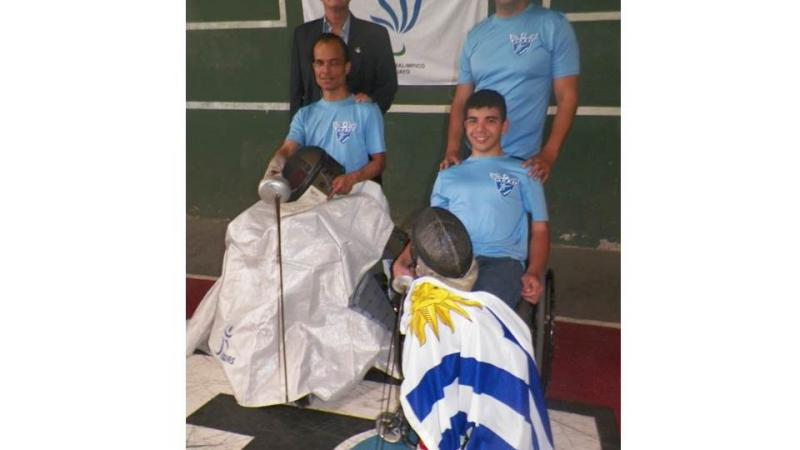 Wheelchair fencing athletes of Uruguay received their new IWAS fencing aprons.