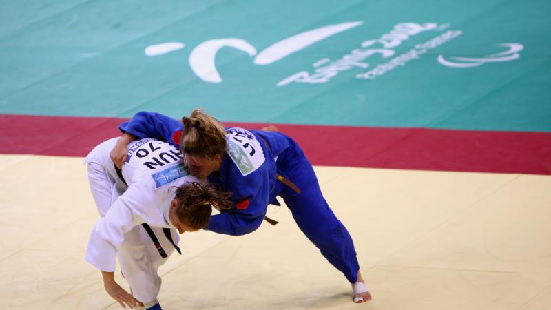 two judo players competing