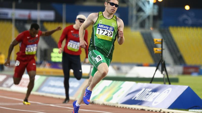 a male competing for Ireland wearing green clothes