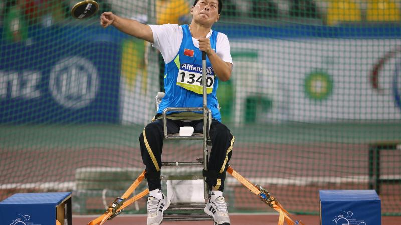 Chian's Liwan Yang competes in the women's discus F55 final during the 2015 IPC Athletics World Championships in Doha, Qatar.