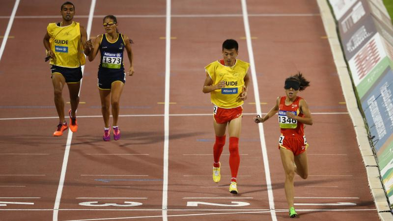 China's Jin Zheng celebrates winning the women's 1500m T11 final during the 2015 IPC Athletics World Championships.