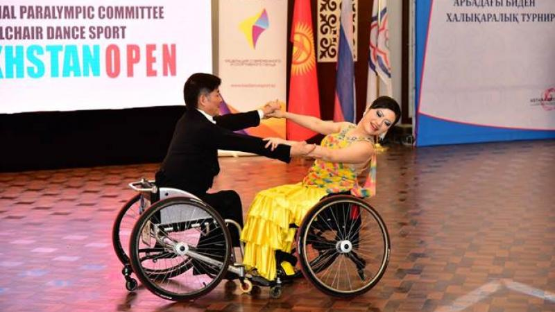 Man and woman in wheelchairs dancing