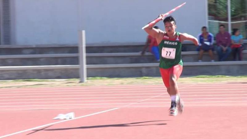 A young boy throwing a javelin