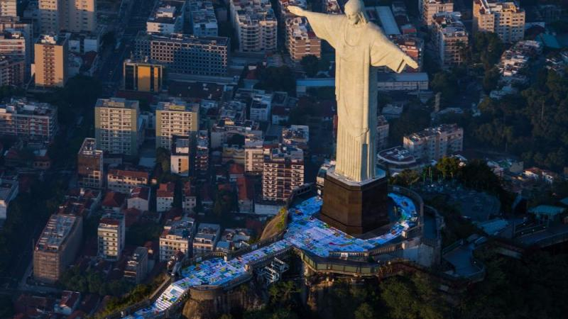 The giant flag was divided into seven pieces to be transported up to the Christ statue