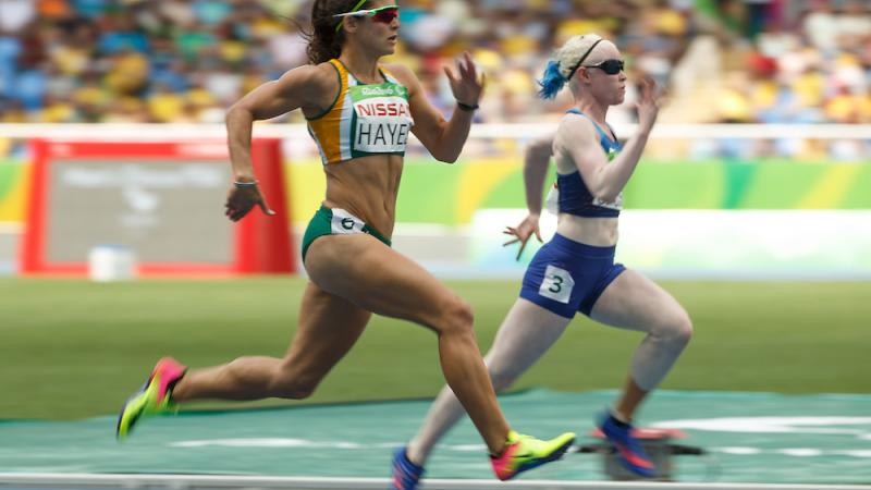 Ilse Hayes RSA and Kym Crosby USA compete in the Heat 2 of the Women's 100m - T13 at the Olympic Stadium.