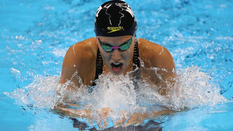 Close up of swimmer doing breast stroke