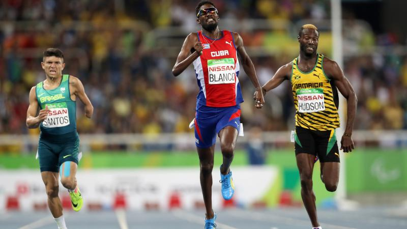 Three men finishing in the men's 400m competition