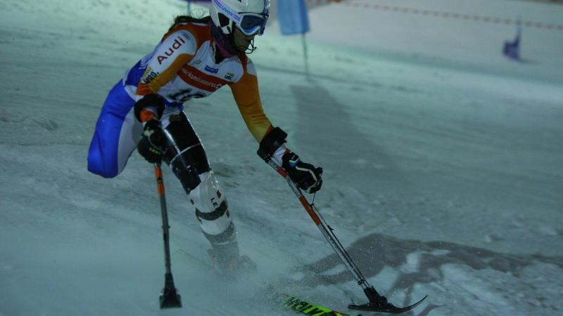 Woman with one leg skiing down a slope