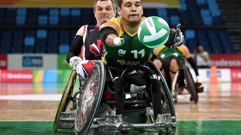 A wheelchair rugby player chasing for the ball