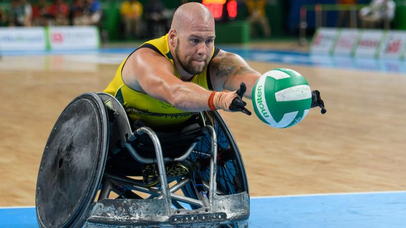 Ryley Batt AUS enters the scoring zone in the Gold Medal Match in the Mixed Wheelchair Rugby Between AUS and USA