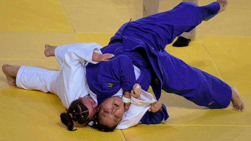 Yanping Yuan (blue) of China with Alimova Khayitjon of Uzbekistan during the Women +70 kg Judo Gold Medal match on Day 3 of the Rio 2016 Paralympic Games