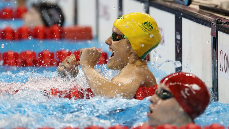 Ellie Cole of Australia celebrates winning the gold medal in the Women's 100m Backstroke - S9 Final on day 9 of the Rio 2016 Paralympic Games