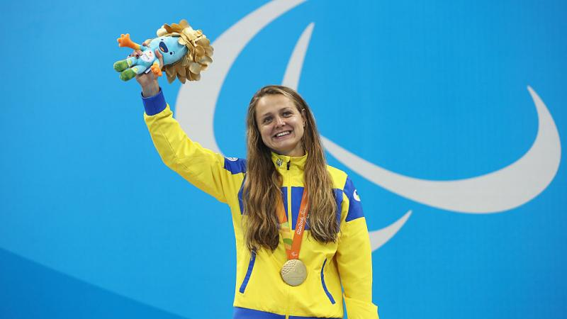 Gold medalist Anna Stetsenko of Ukraine celebrates on the podium at the medal ceremony for the Women's 100m Backstroke - S13 on day 10 of the Rio 2016 Paralympic Games