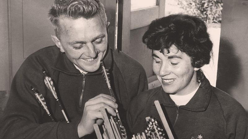 A smiling couple on a black and white picture