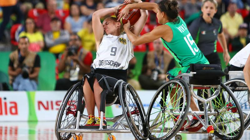 female wheelchair basketball player Laura Fuerst fighting with another player for the ball