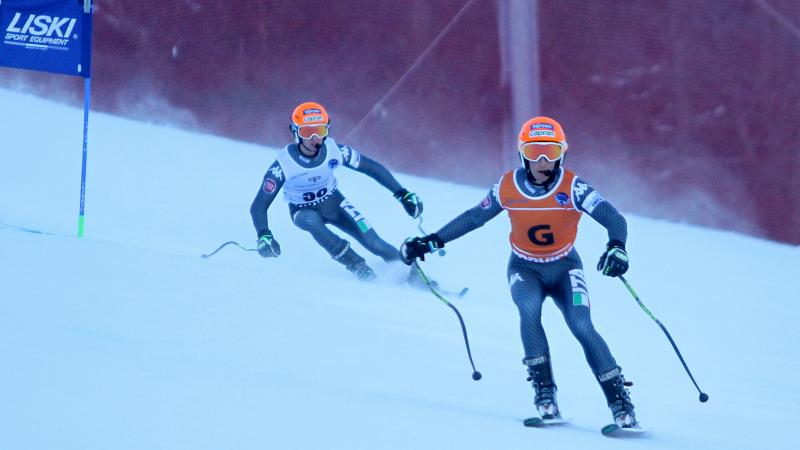 A visually impaired skier takes a bend