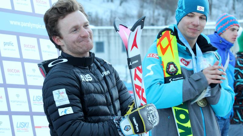 a Para skier smiles with his skies