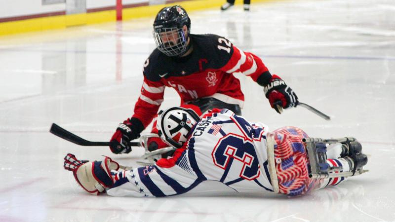 Steve Cash making a save against Greg Westlake in the gold medal game USA v Canada at the 2015 IPC Ice Sledge Hockey World Championships A-Pool in Buffalo, USA.