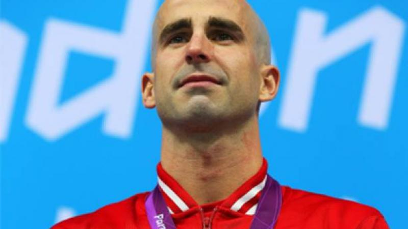 A picture of a man during a medal ceremony