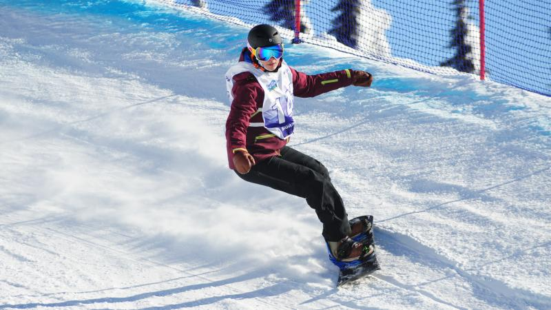 Woman on snowboard turns on a banked turn