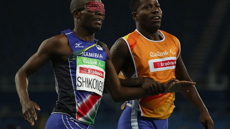 Ananias Shikongo and his guide Even Tjiviju of Namibia celebrates winning the gold medal in the Men's 200m - T11 Final at the Rio 2016 Paralympic Games.