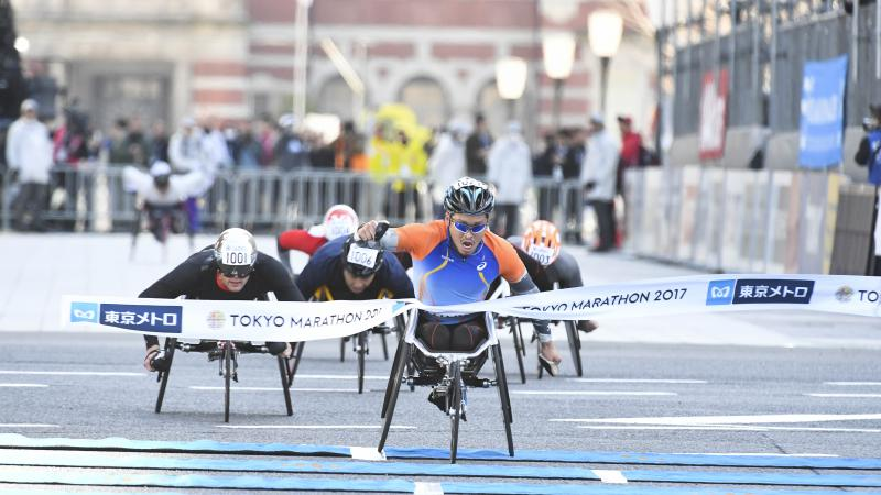Japan's Sho Watanabe crosses the line to take the 2017 Tokyo marathon ahead of Switzerland's Marcel Hug.