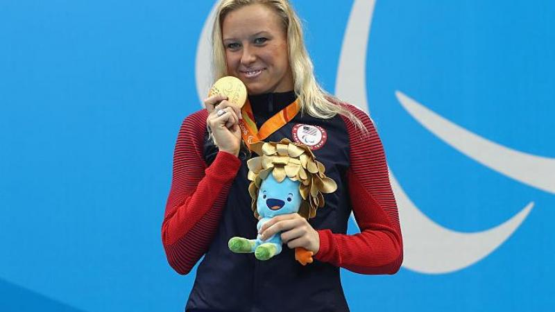 Gold medalist Jessica Long of the United States celebrates on the podium at the medal ceremony for Women's 200m Individual Medley - SM8 at the Rio 2016 Paralympic Games.