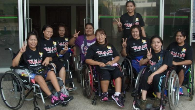 Group of Asian women's wheelchair basketball players pose