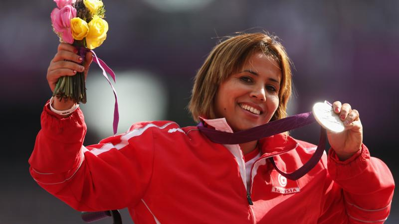 Tunisia's silver medallist Hania Aidi on the podium during the medal ceremony for the women's javelin F54/55/56 at the London 2012 Paralympic Games.