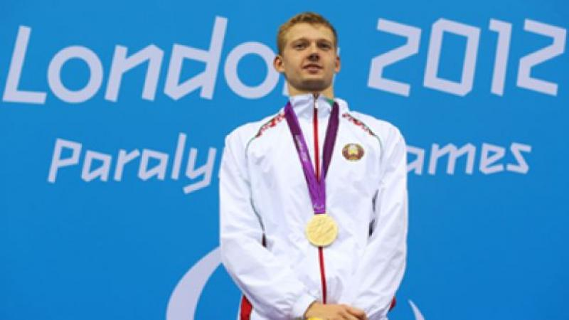A picture of a man with a gold medal around his neck