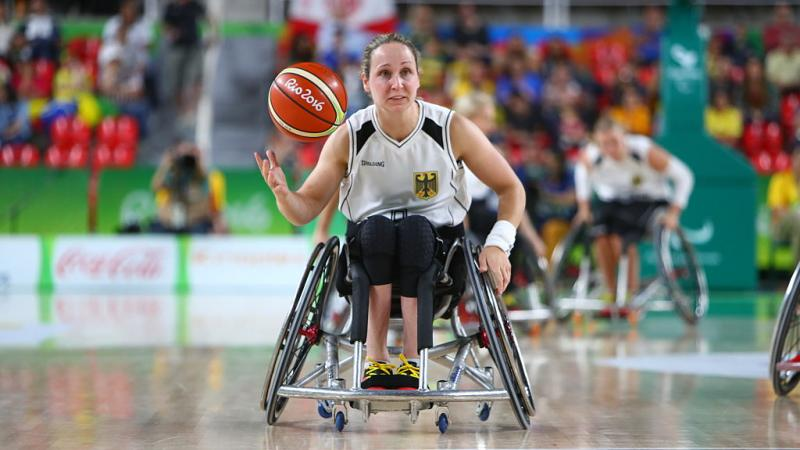 a wheelchair basketballer goes for a shot