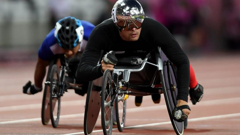 a wheelchair racer crosses the finish line
