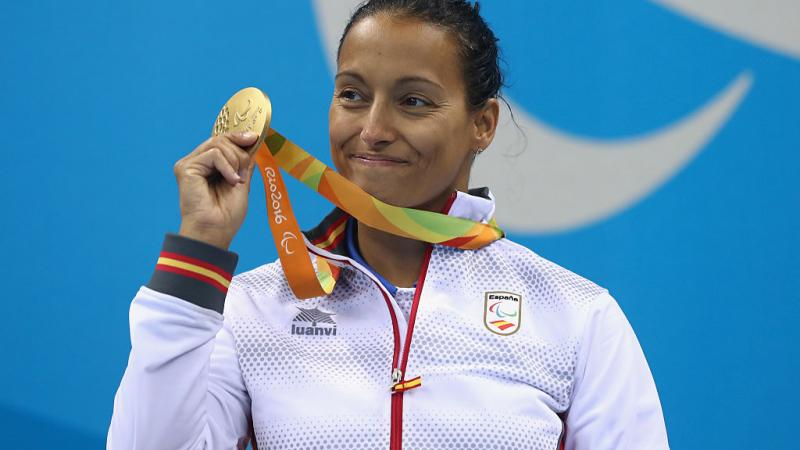 a Para swimmer celebrates with her medal